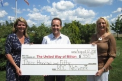 Rob Duvall and his wife Carol, present cheque to Leslie McLaren of United Way Milton